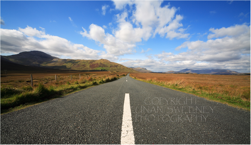 Big  sky  Connemara.  The  road  to  Kylemore